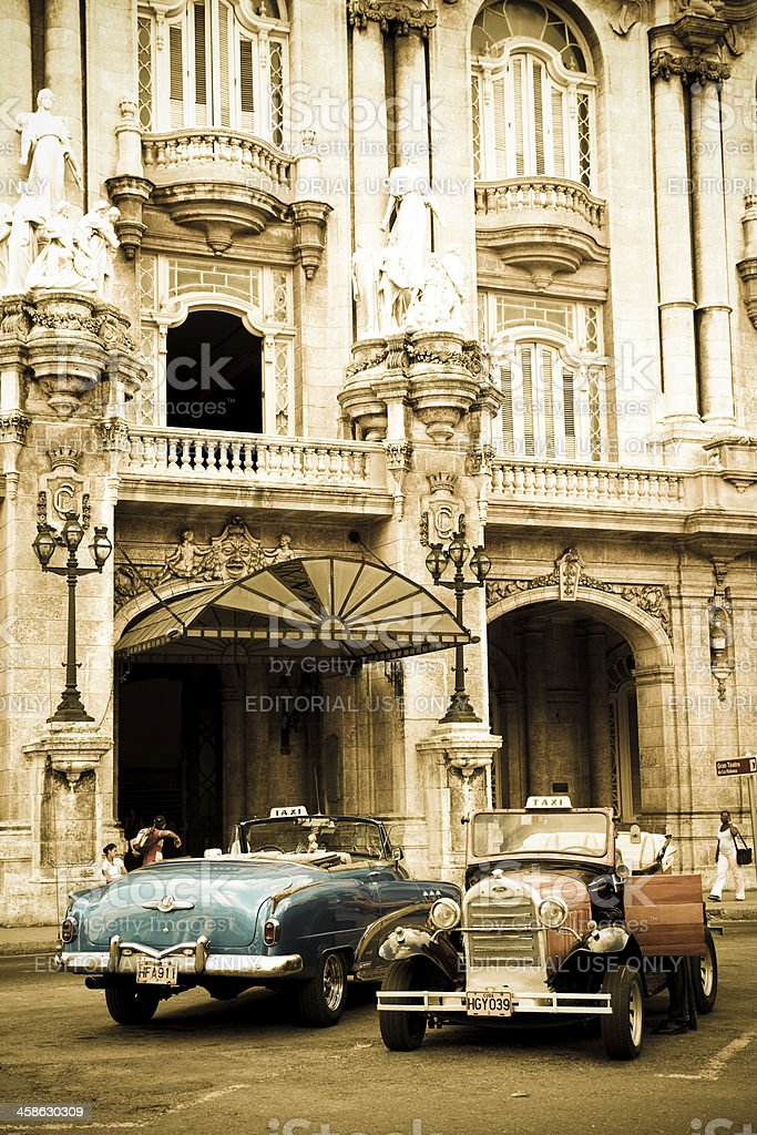 Two well-preserved old cars in Havana Vieja royalty-free stock photo