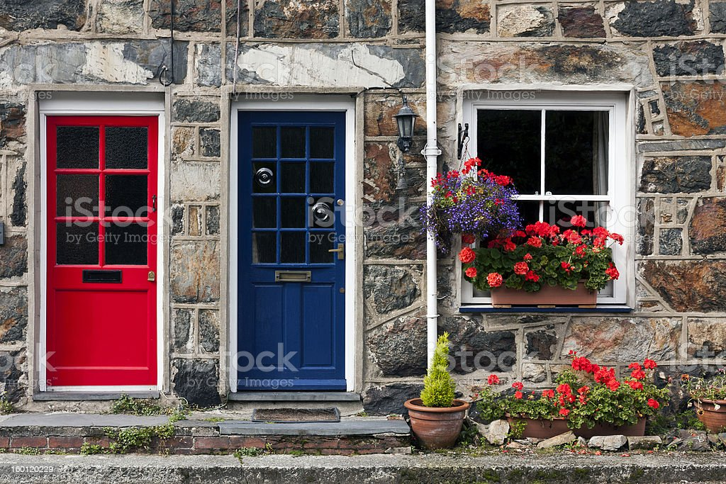 Two welsh cottages, one has a blue door & the other is red stock photo