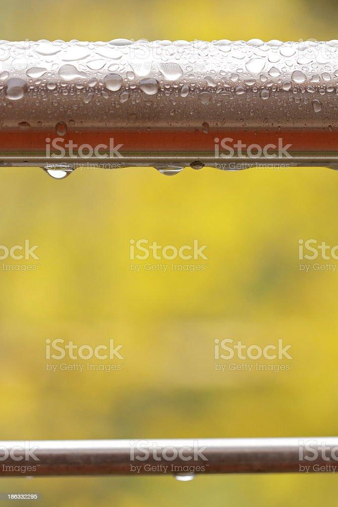 Two wet steel bars stock photo