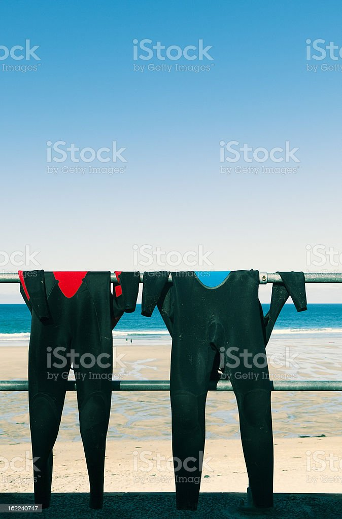 Two Wetsuits stock photo