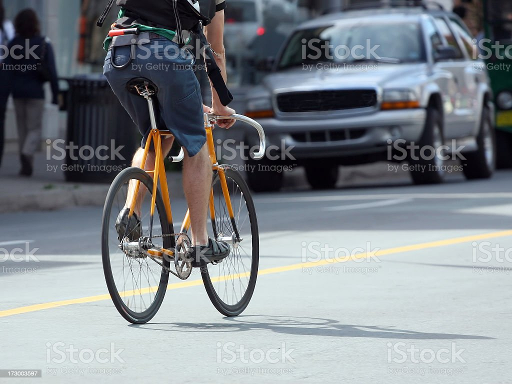 Two Wheeling On A Downtown City Street stock photo