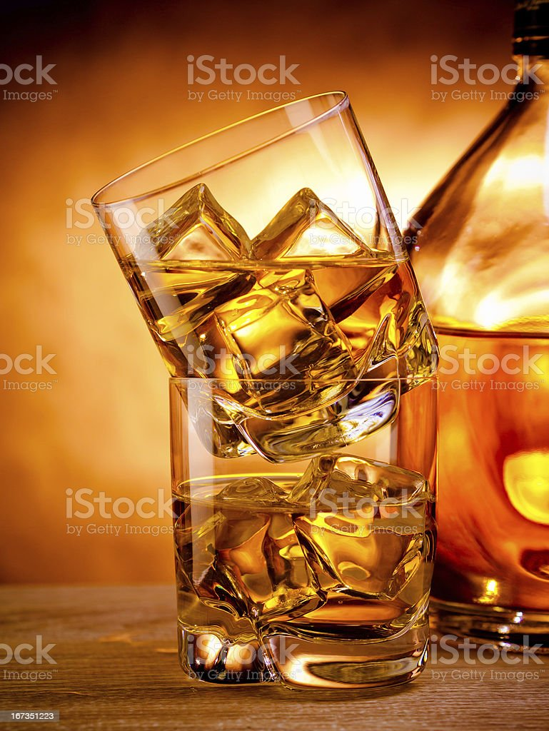 Two whiskeys and a bottle royalty-free stock photo