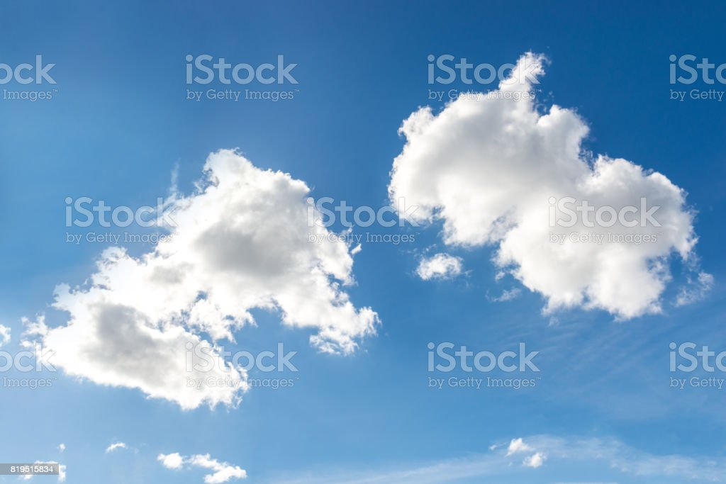Two white clouds on the blue sky background stock photo
