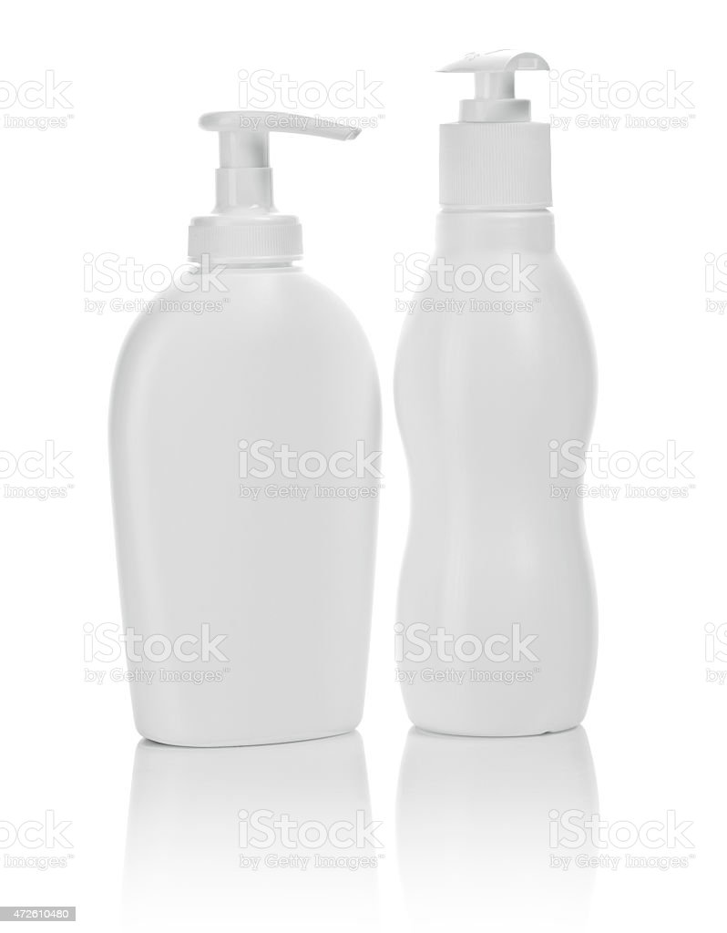 two white cosmetical bottles isolated stock photo