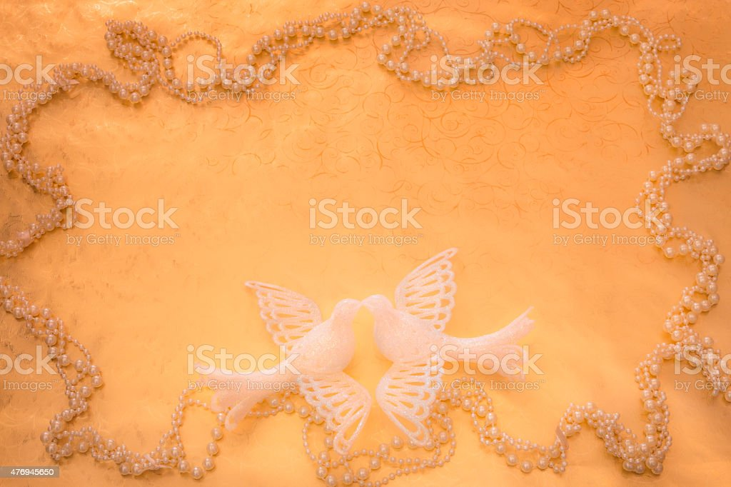Two white Doves on gold paper with pearls background (P) stock photo