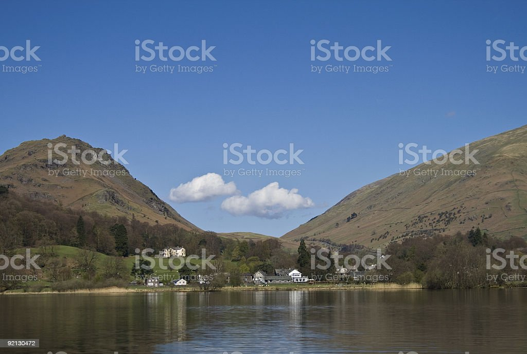 Two White Fluffy Clouds in a Valley stock photo