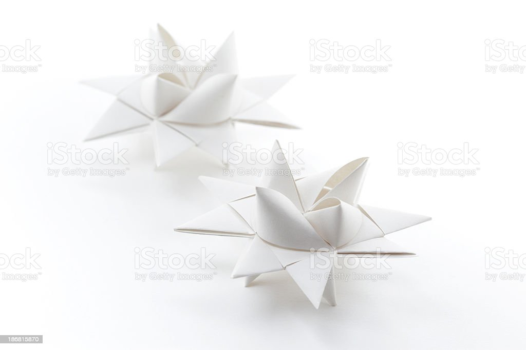 Two white folded paper origami Moravian Star decorations royalty-free stock photo