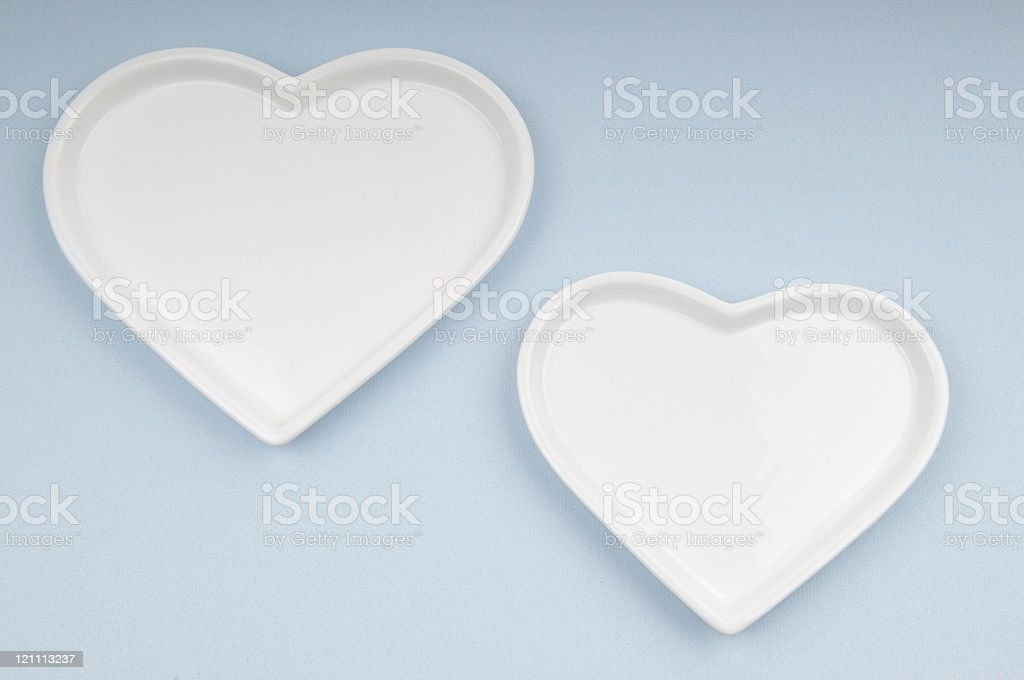 Two White Hearts on Blue Background royalty-free stock photo
