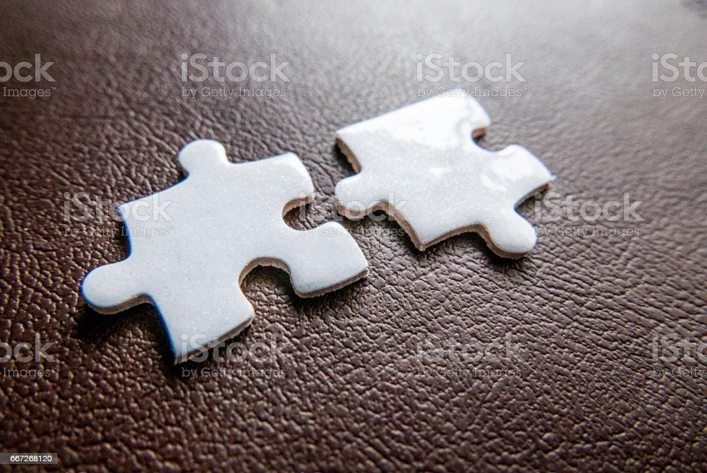 Two white jigsaw pieces stock photo