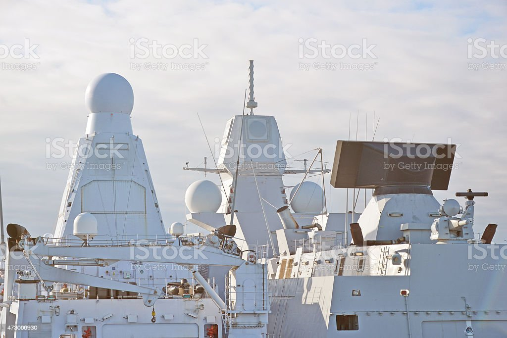 Two white naval ships with radar and other communications. stock photo