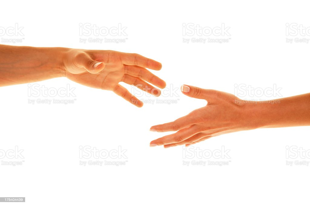 Two white people reaching their hands out to each other stock photo