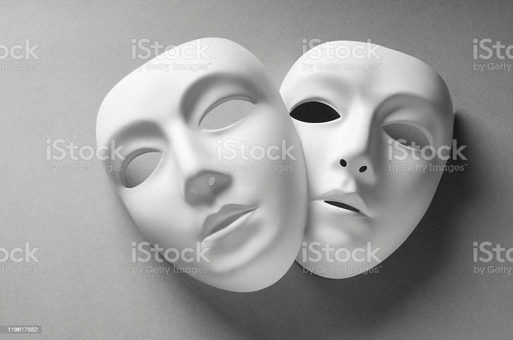 Two white plastic masks representing the theater stock photo