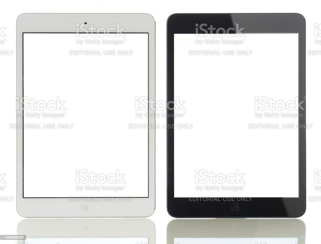 Two white screen Apple iPad Mini royalty-free stock photo