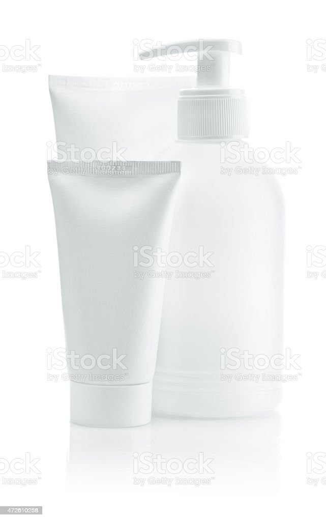 two white tube and bottle isolated stock photo
