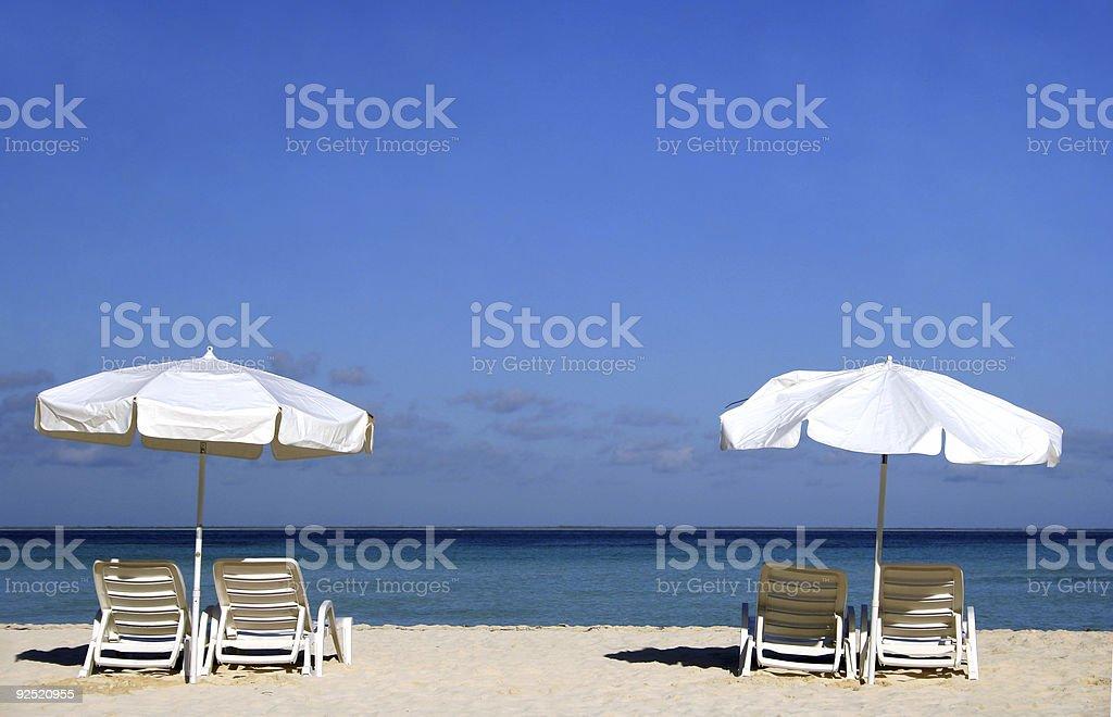 Two White Umbrellas royalty-free stock photo