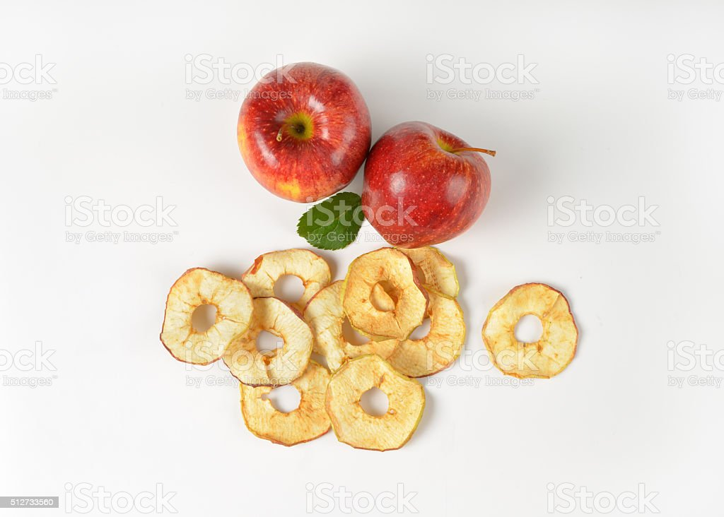 two whole apples and dried apple rings stock photo