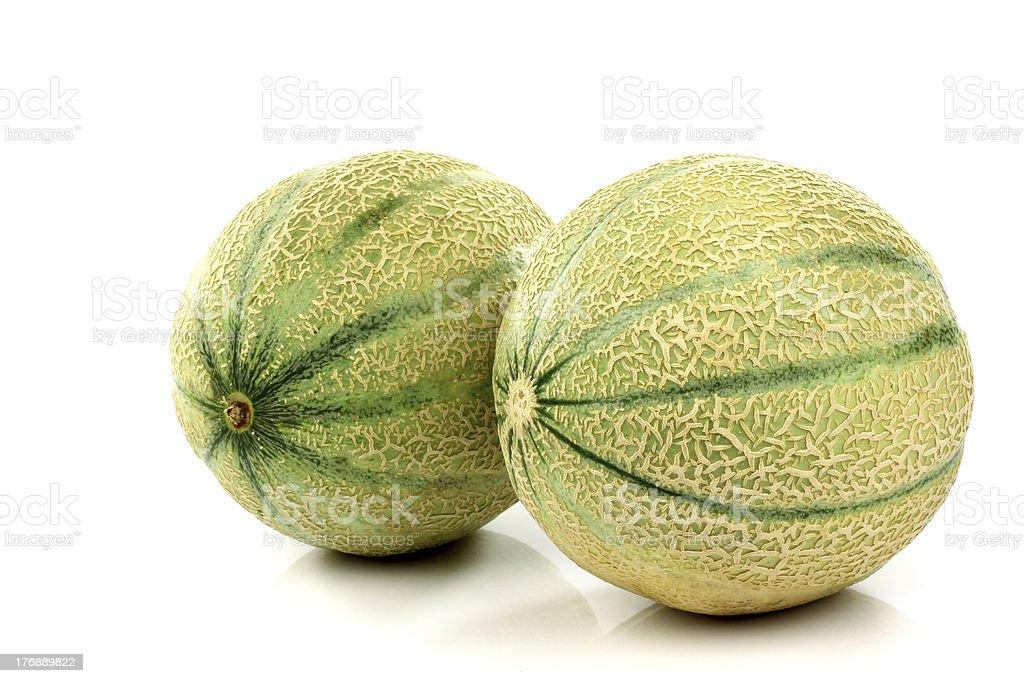 two whole cantaloupe melons stock photo