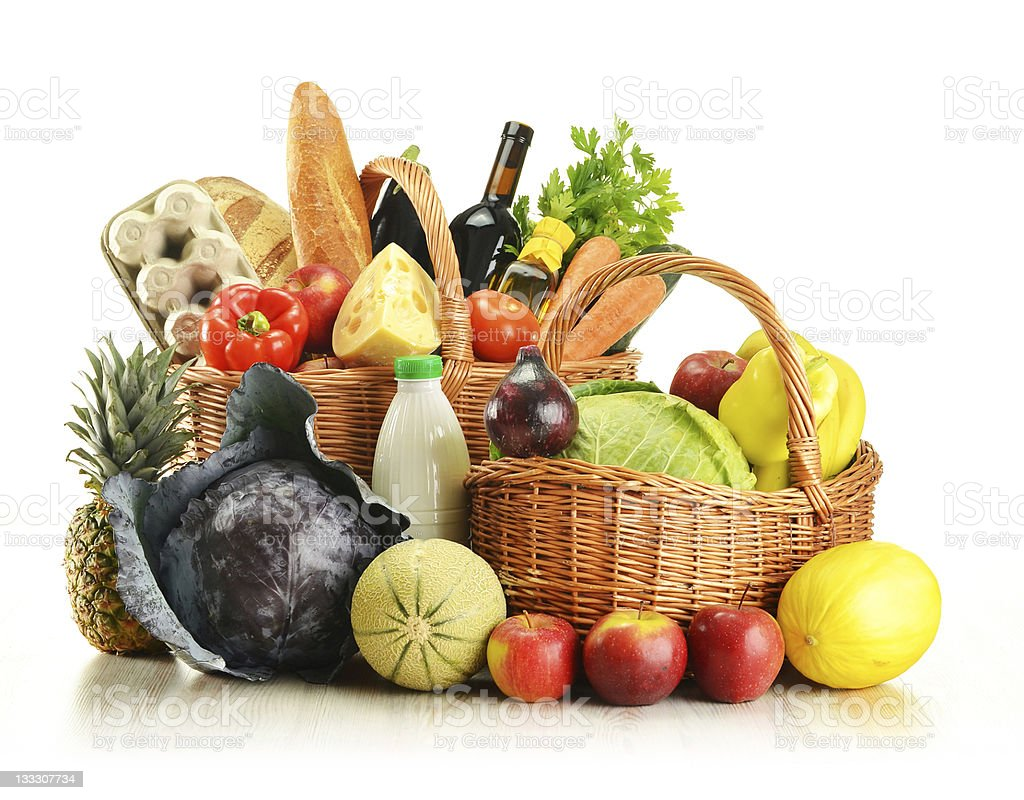 Two wicker baskets with groceries royalty-free stock photo