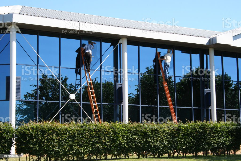 Two window cleaners at work stock photo