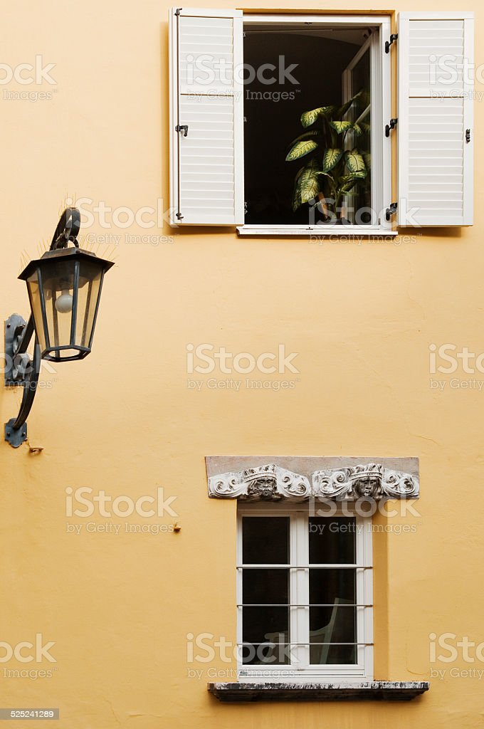 two windows and a lantern stock photo