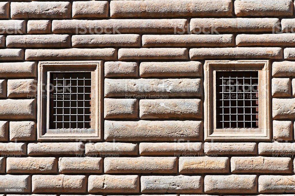 Two Windows on Ashlar Stone Facade, Italian Architecture in Firenze stock photo