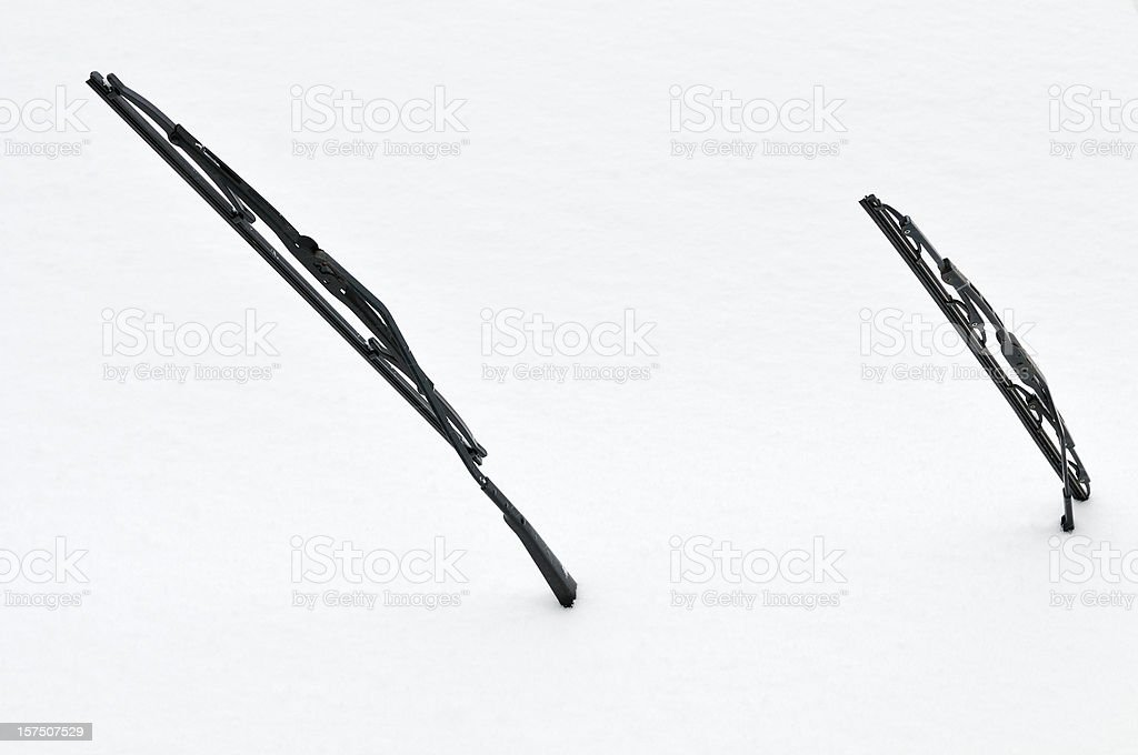 Two windscreen wipers poking out of a blanket of snow stock photo