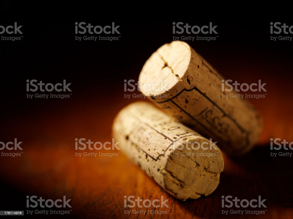 Two Wine Bottle Corks on a Wooden Table stock photo