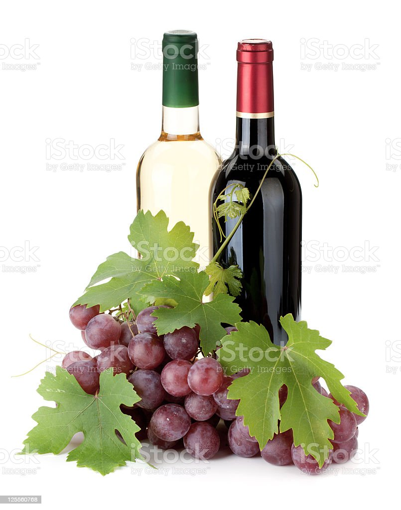 Two wine bottles and grapes royalty-free stock photo
