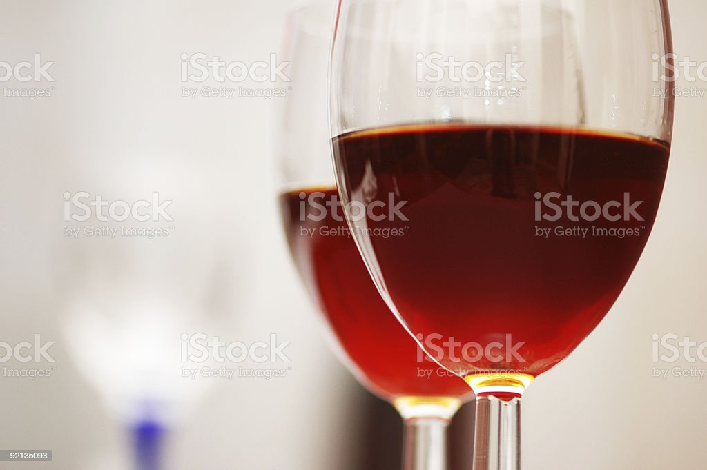 Two wine glasses against the white background royalty-free stock photo
