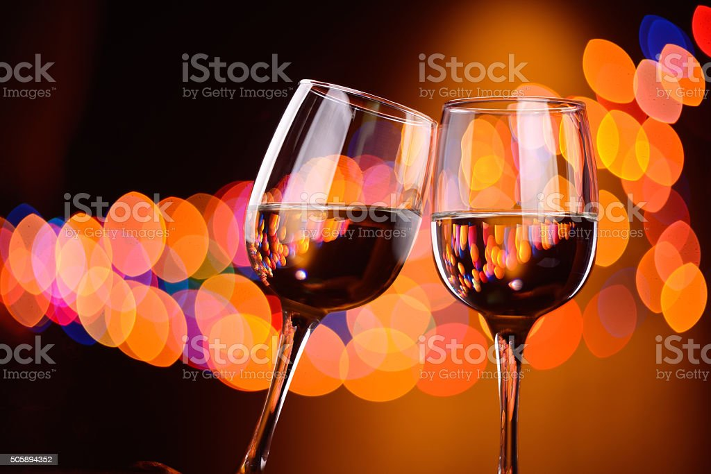 Two wine glasses clink at the party stock photo