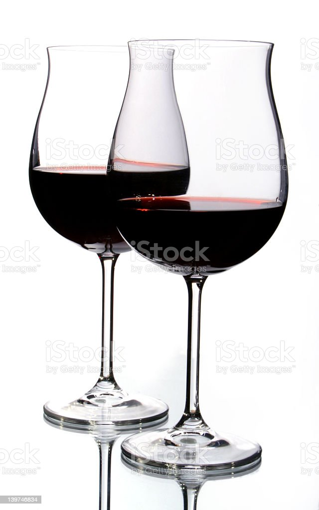 Two wine glasses filled with red wine royalty-free stock photo