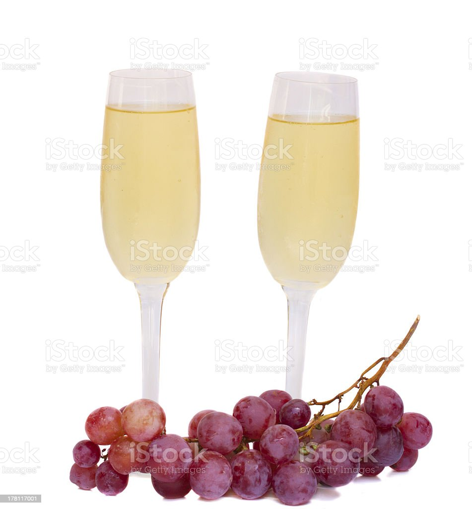 two wine glasses with grape royalty-free stock photo