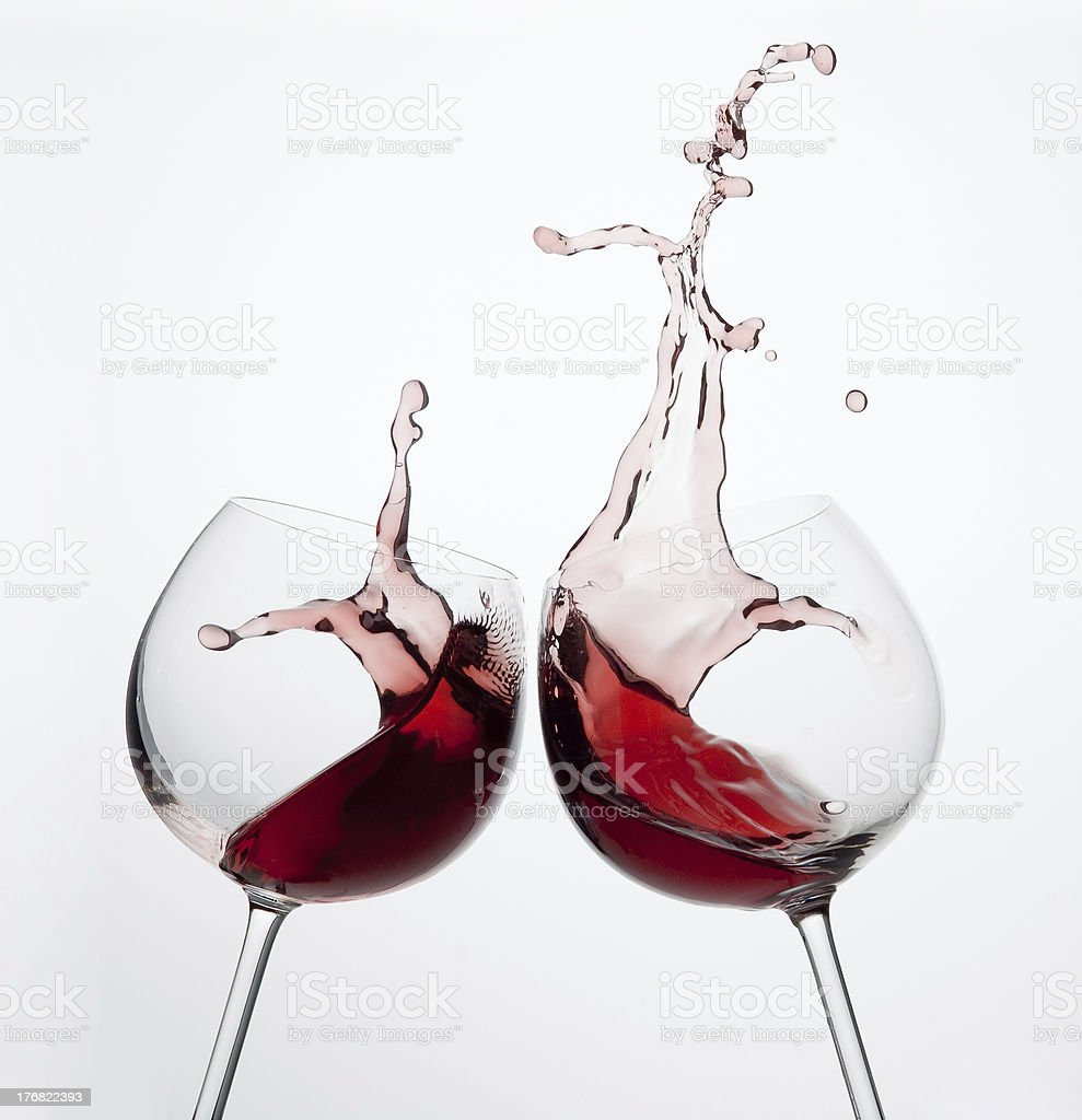 Two wine glasses with splash royalty-free stock photo
