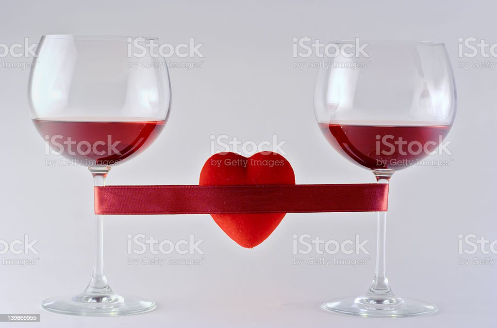 Two wine glasses wrapped with tape and heart royalty-free stock photo