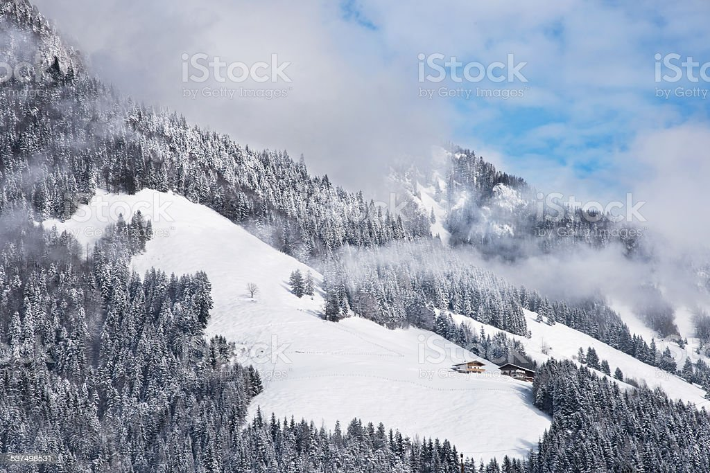Two winter chalets by the mountain stock photo