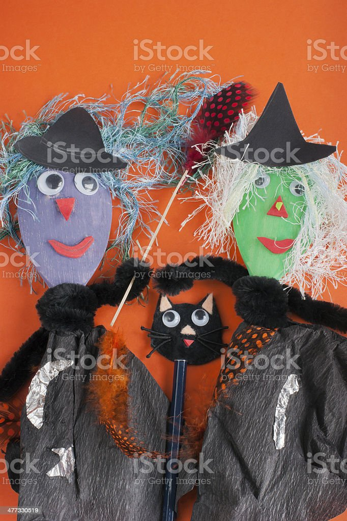 Two witches and a cat, Halloween toys. stock photo