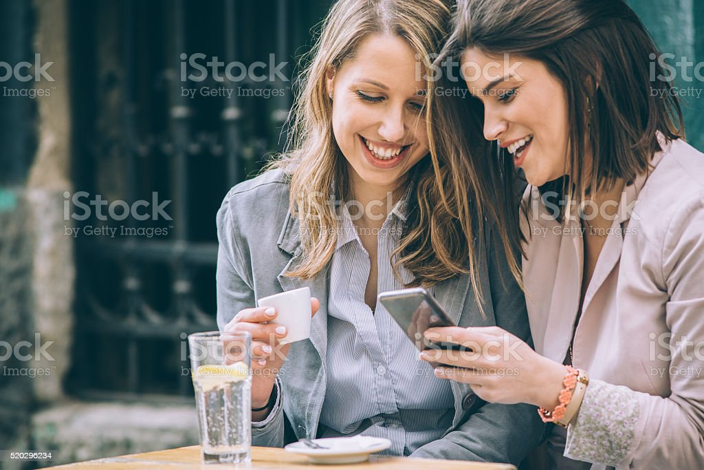 Two woman at cafe stock photo