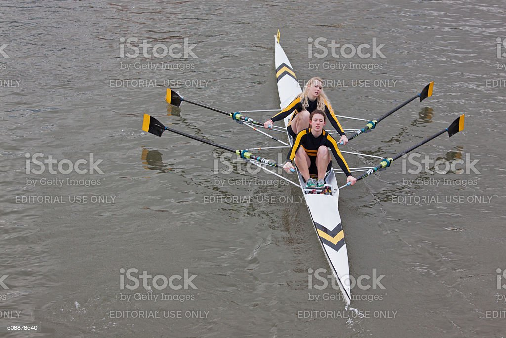 Two woman crew pulling in harmony during a river race stock photo