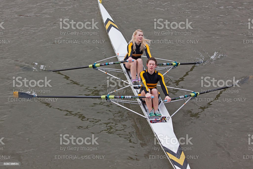 Two woman crew pulling together during a river race stock photo