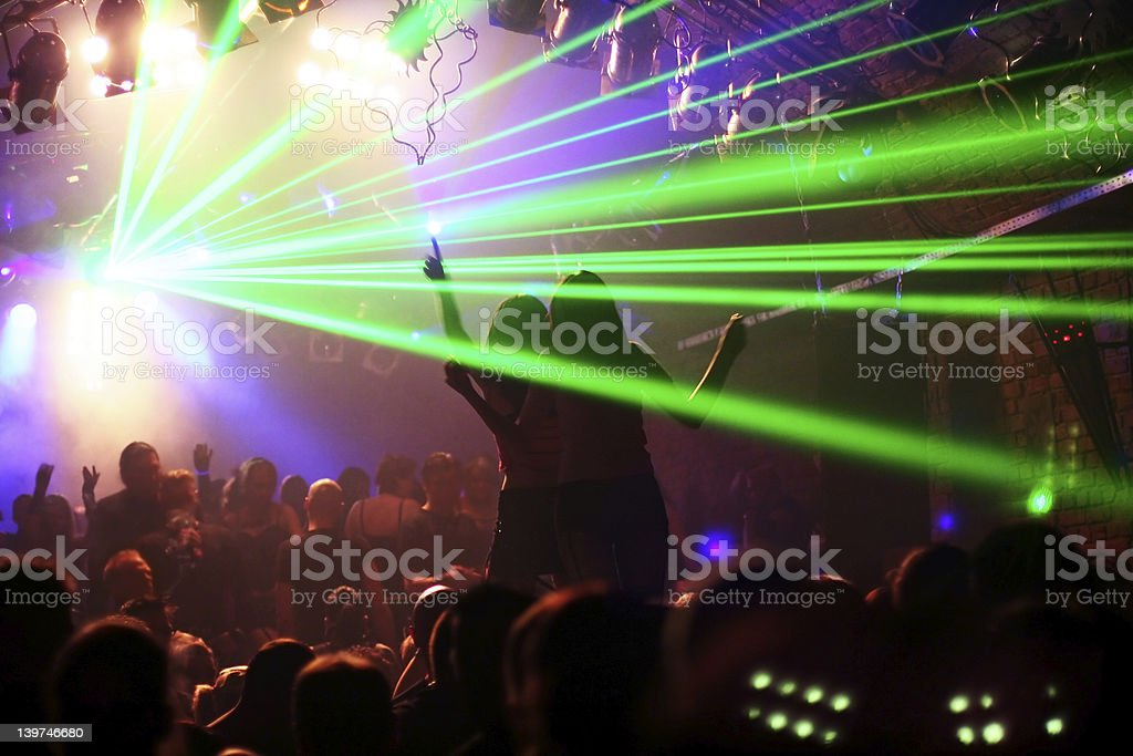 two woman dancing on a platform royalty-free stock photo