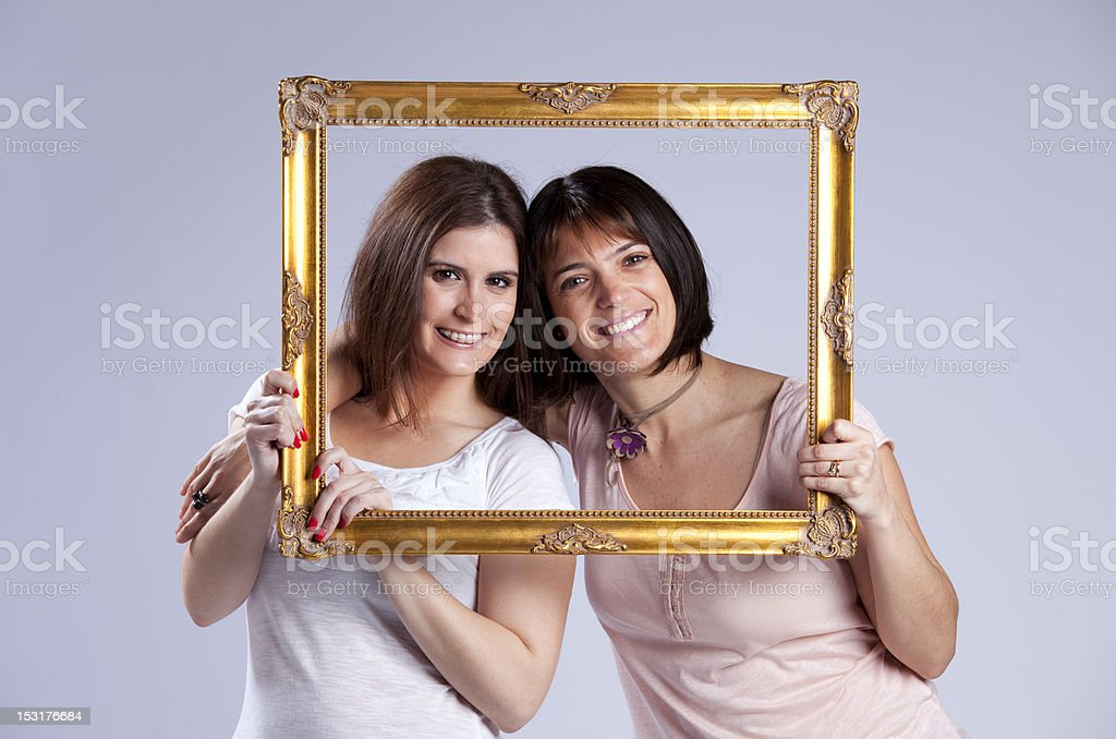 two woman inside a picture frame royalty-free stock photo
