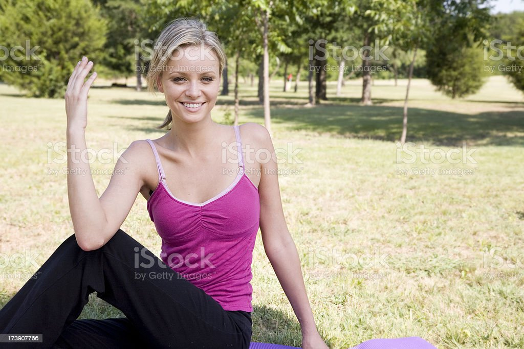 Two Woman Reaching Up To The Sky While Stretching Outside royalty-free stock photo