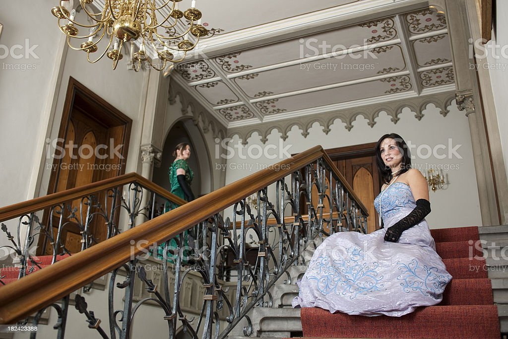 Two woman sitting on stairs royalty-free stock photo