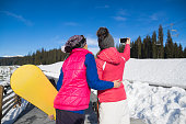Two Woman Ski And Snowboard Resort Winter Snow Mountain Girls