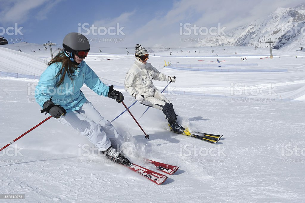 Two woman skiers in the action royalty-free stock photo