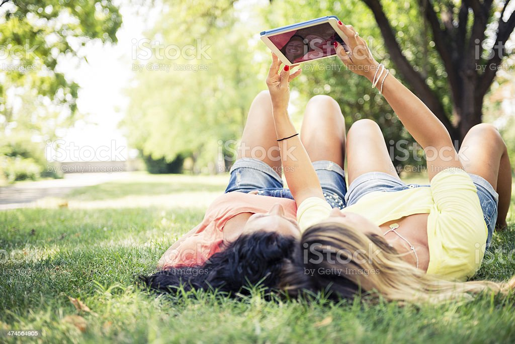 Two woman using digital tablet royalty-free stock photo