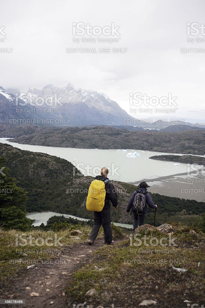 Two womans trekkingd down royalty-free stock photo