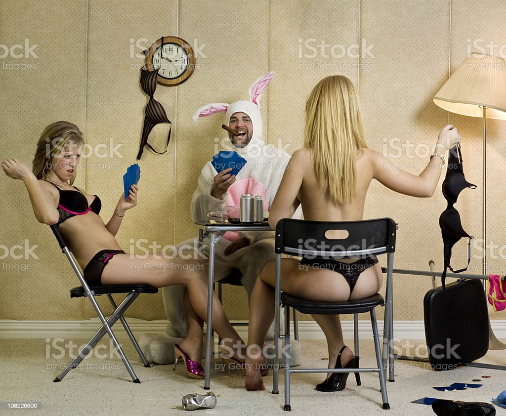 Two Women and Man Playing Strip Poker stock photo