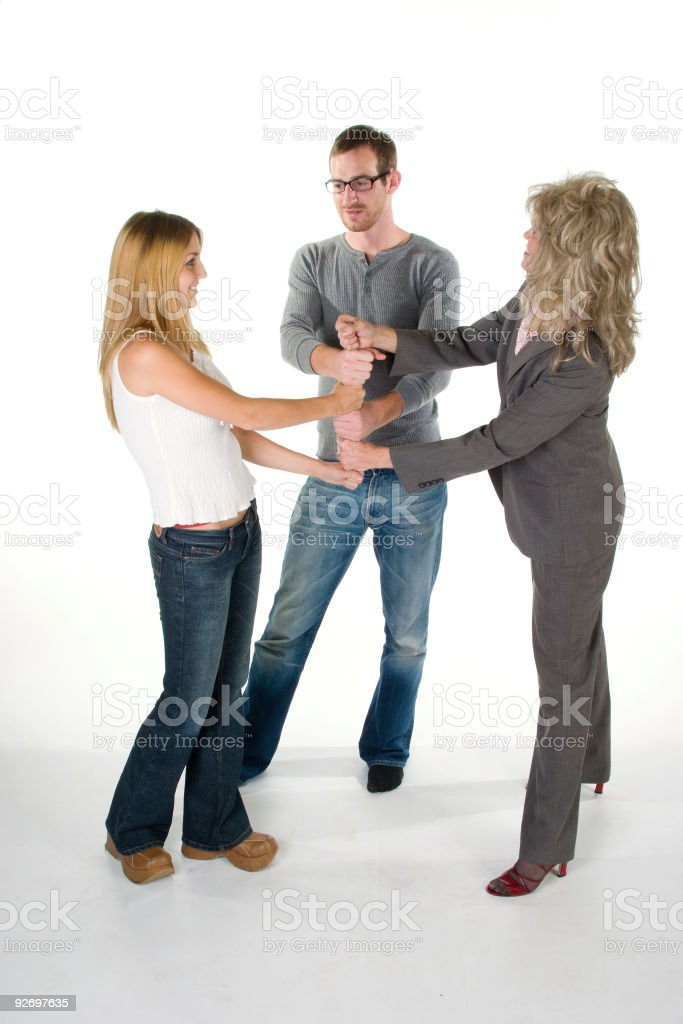 Two Women And Man With Stacked Fists royalty-free stock photo