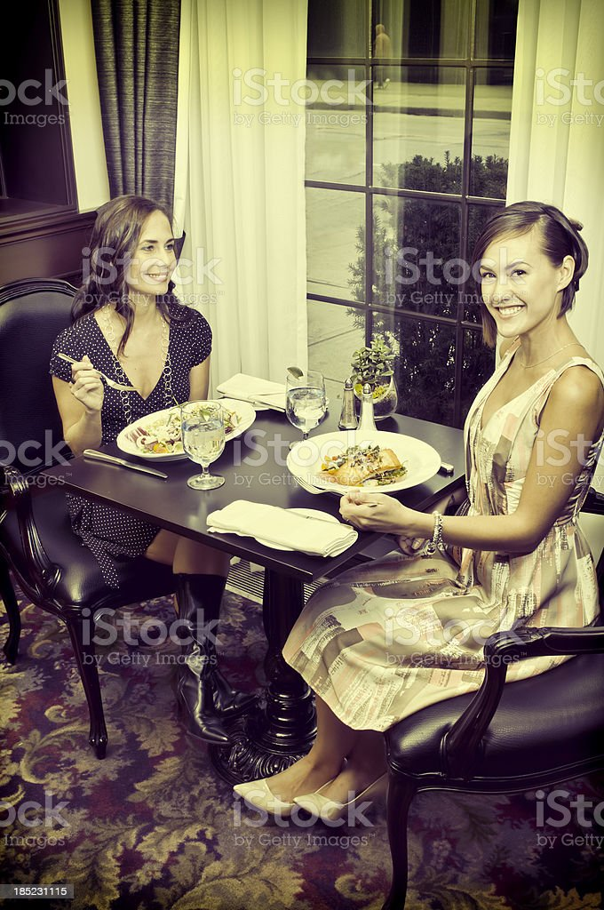 Two women are having dinner at the restaurant - II stock photo
